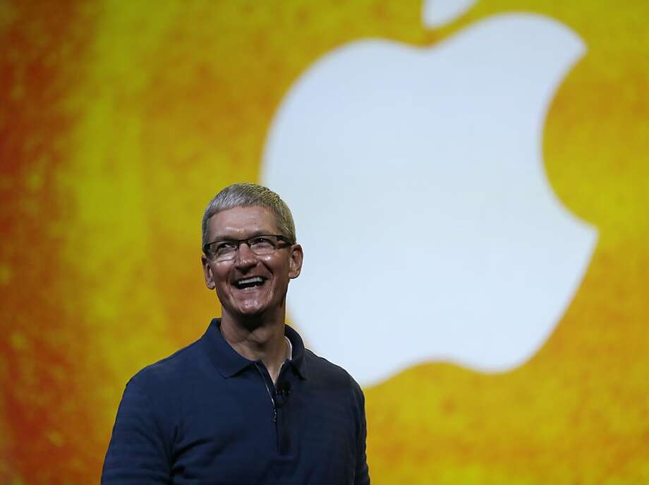 CEO Tim Cook instituted Apple dividends last year. Photo: Marcio Jose Sanchez, Associated Press