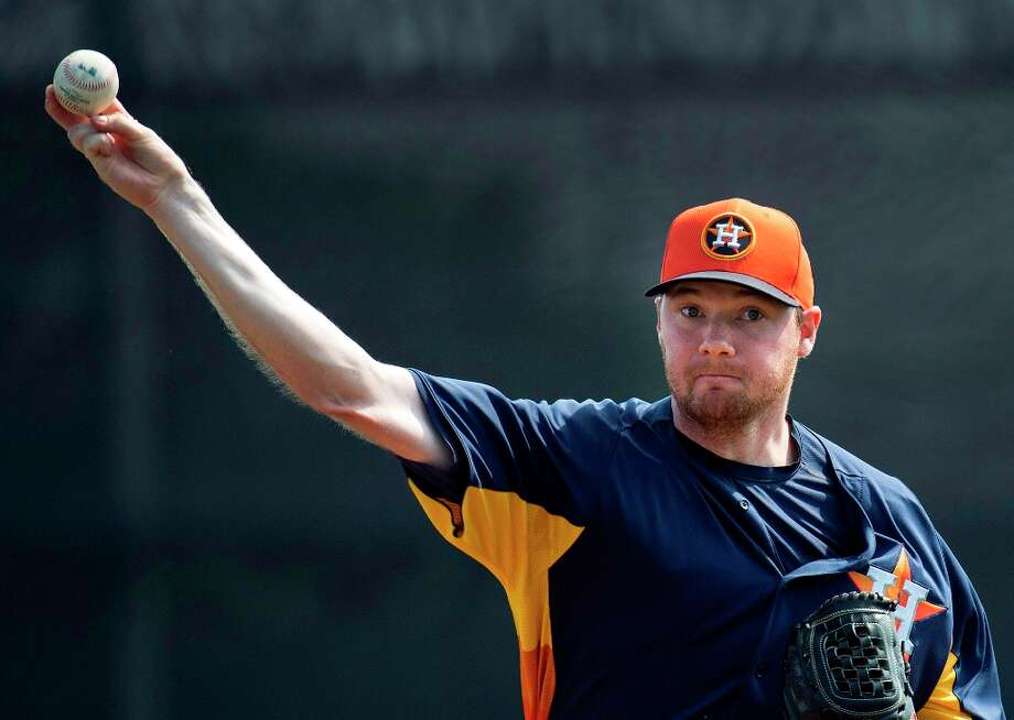 Astros pitcher Alex White throws against the Blue Jays during the first inning. Photo: Nathan Denette