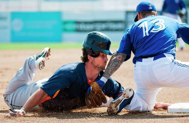 Blue Jays third baseman Brett Lawrie, right, tags out Astros' Brett Wallace, left, at third base during the third inning. Photo: Nathan Denette
