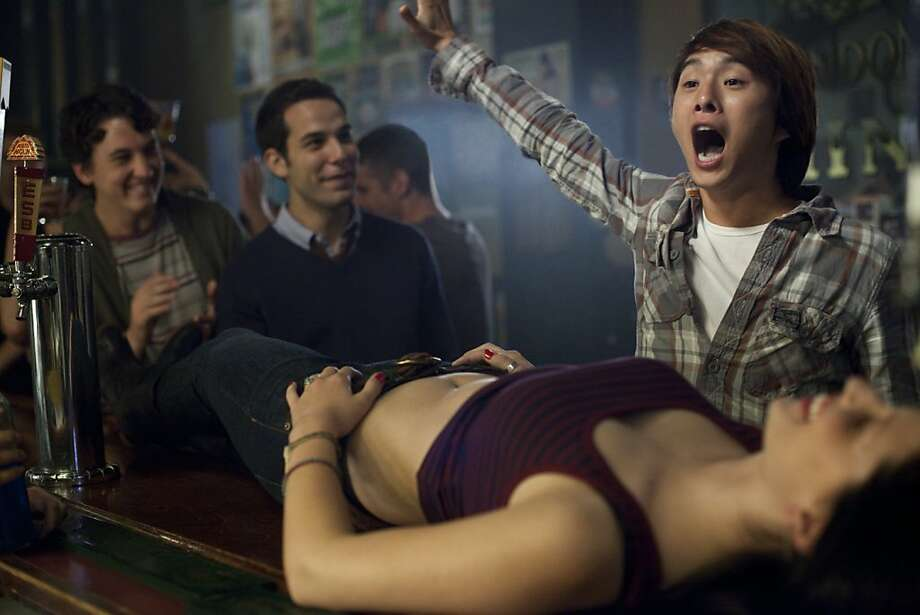 "Skylar Astin (left) and Justin Chon star in the edgy comedy ""21 and Over."" Photo: John Johnson, Relativity Media"