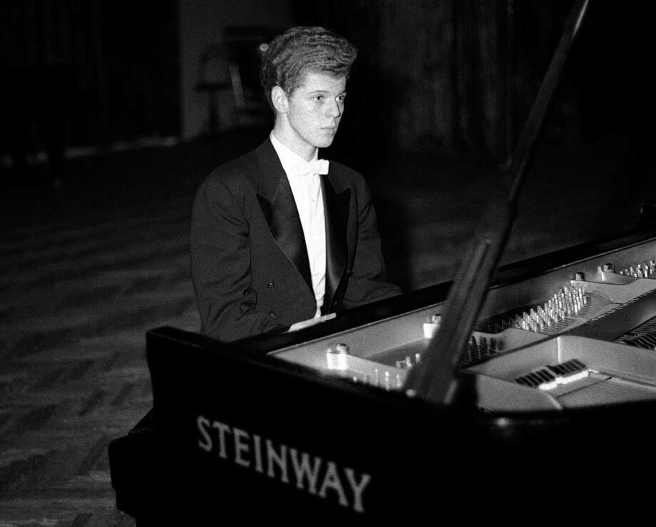 FILE - This April 11, 1958 file photo shows pianist Van Cliburn performing in final round of Tchaikovsky International Piano & Violin competition in Moscow.  Cliburn, the internationally celebrated pianist whose triumph at a 1958 Moscow competition helped thaw the Cold War and launched a spectacular career that made him the rare classical musician to enjoy rock star status  died early Wednesday, Feb. 27, 2013, at his Fort Worth home following a battle with bone cancer.  He was 78. (AP Photo, file) / AP
