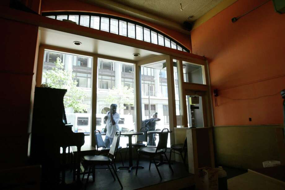12. The Boomtown Cafe on 3rd Avenue welcomed everyone, no matter how poor. Customers got a hot meal in exchange for a quarter and 15 minutes of work in the restaurant. Otherwise, a meal was $2. It closed in 2005. Photo: Scott Eklund / Seattle Post-Intelligencer