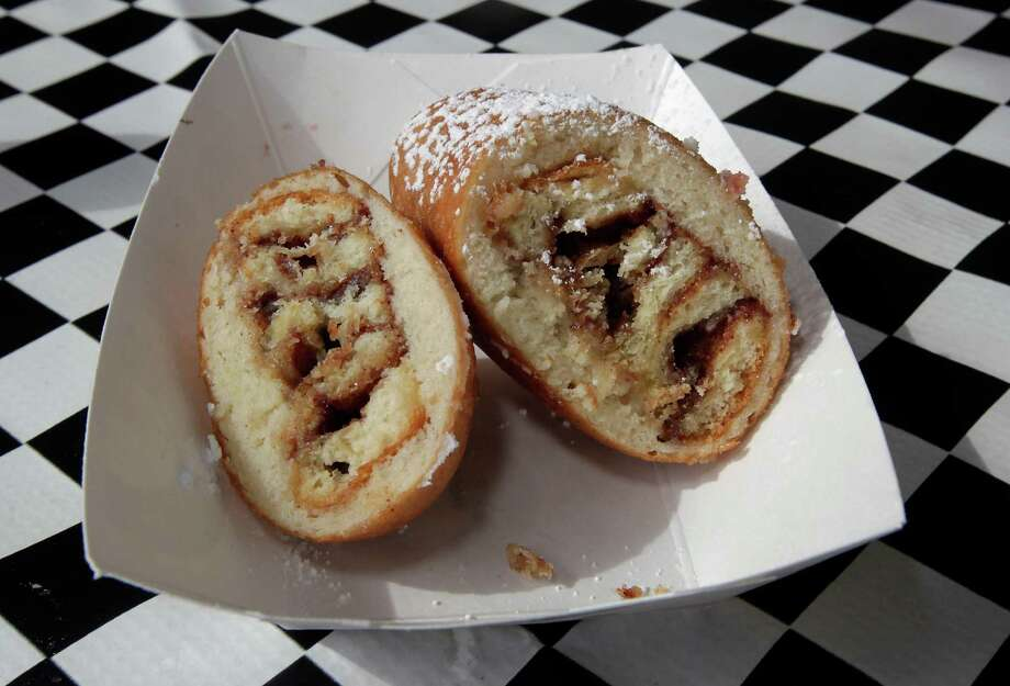 The Deep Fried Cinnamon Rolls available at the at the Houston Livestock Show and Rodeo Carnival 2013. Photo: James Nielsen, Staff / © 2013  Houston Chronicle