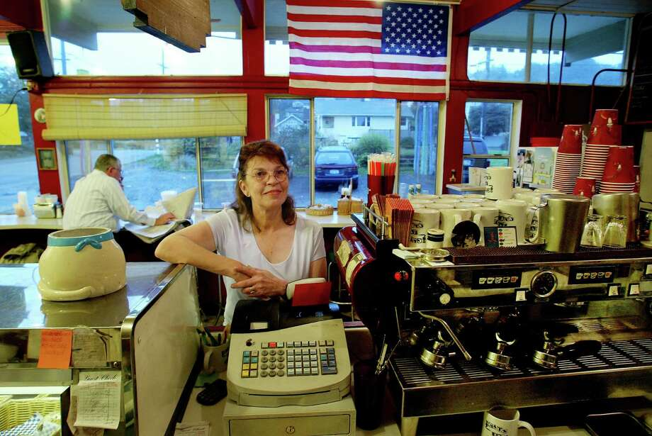 18. The Cat's Eye Cafe was a cozy place near Lincoln Park, known for its sandwiches, brownies and American flag, which owner Penny Ratliff (pictured) had raised while her husband was serving in Iraq. Photo: PAUL JOSEPH BROWN