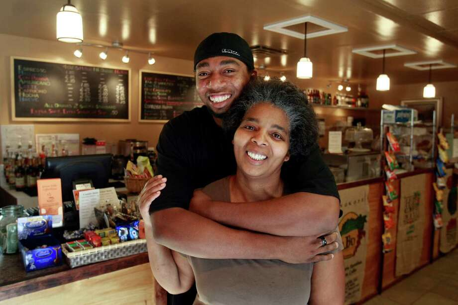 21. When Grown Folks Coffeehouse opened in 2008, Beacon Hillers cheered for their own friendly, family-run café. But its building was slated for redevelopment, and the coffee was short-lived. Pictured are Illume Miller and son Gary Grant, who ran the cafe. Photo: Meryl Schenker / Seattle Post-Intelligencer