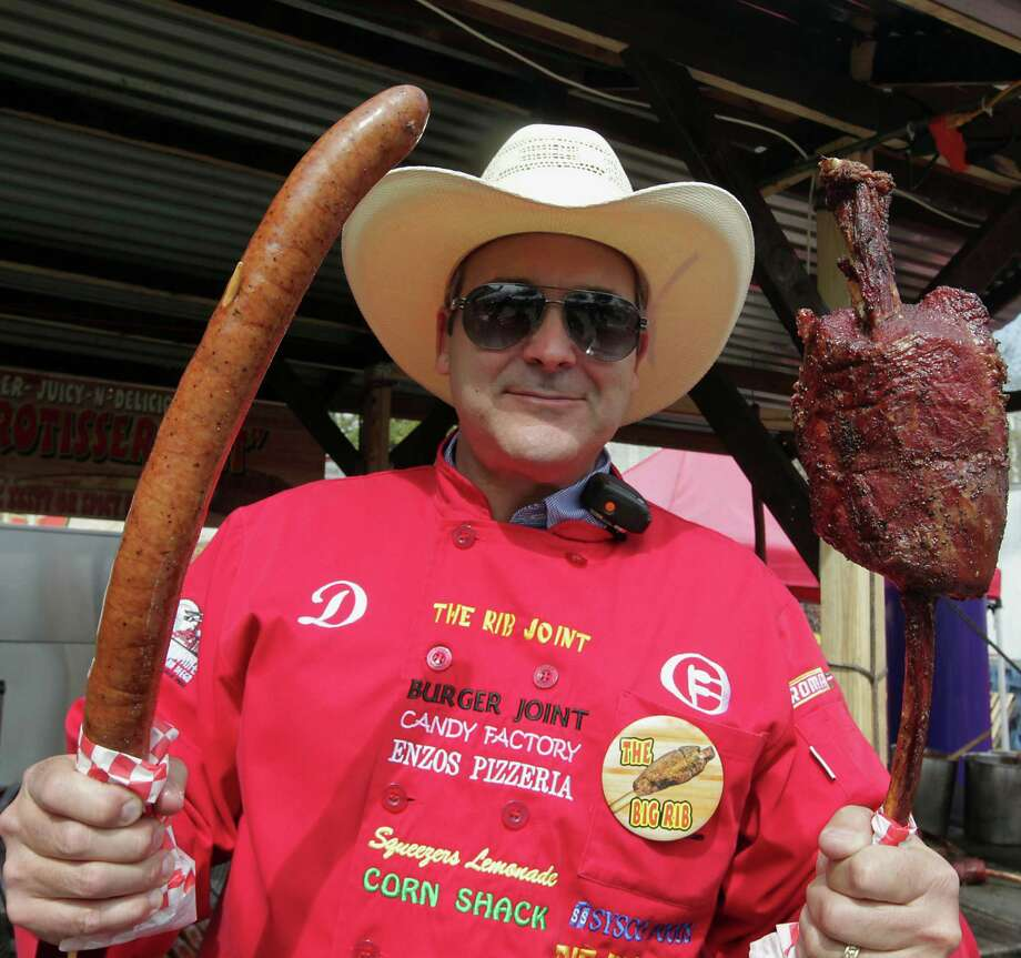 Dominic Palmieri says the 2-foot-long Sausage on a Stick, left, was a big seller at 2013's World's Championship Bar-B-Que Cookoff. The 2-pound Big Rib has been a big hit in years past. Photo: James Nielsen, Staff / © 2013  Houston Chronicle