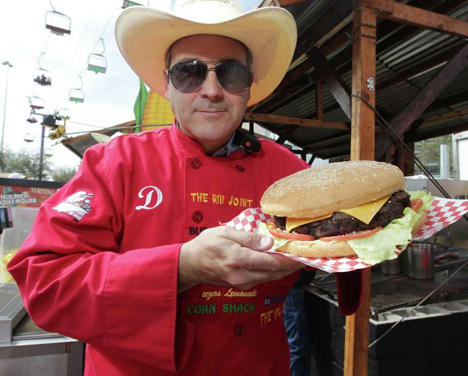 Strange food from Rodeo's past. Take a look at what we've consumed: 4 pound Belly Buster burger) found on the carnival midway. Photo: James Nielsen, Staff / © 2013  Houston Chronicle