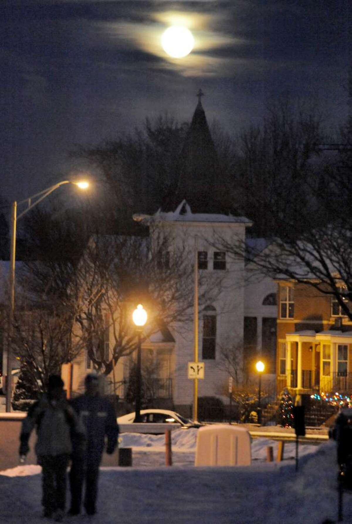 """The blue moon rises over downtown Danbury during 1st Night Danbury, the theme of which is """"Once Upon A Blue Moon"""", on Thursday, Dec.31,2009."""