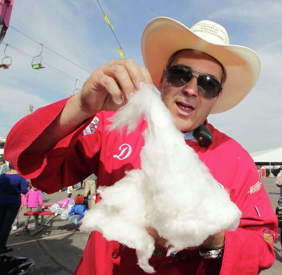 "RSC's Dominic ""The Midway Gourmet"" Palmieri the Chocolate Cotton Candy at the Houston Livestock Show and Rodeo Carnival Saturday, Feb. 23, 2013, in Houston. ( James Nielsen / Houston Chronicle ) Photo: James Nielsen, Staff / © 2013  Houston Chronicle"