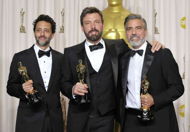 "Grant Heslov, from left, Ben Affleck, and George Clooney pose with their award for best picture for ""Argo"" during the Oscars at the Dolby Theatre on Sunday Feb. 24, 2013, in Los Angeles. Photo: John Shearer, Associated Press / Invision"
