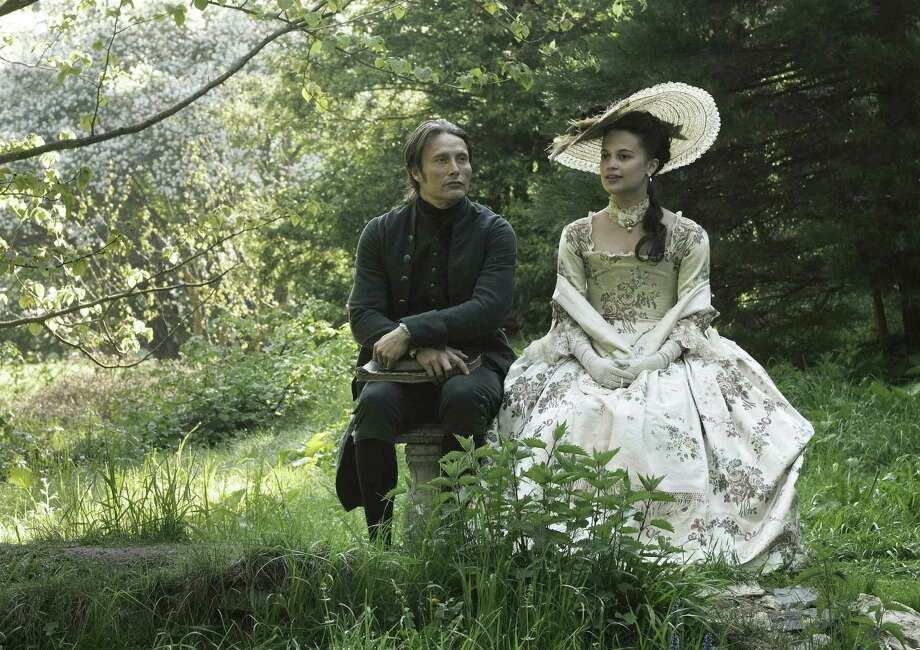 "Mads Mikkelsen plays a German physician and Alicia Vikander is Queen Caroline in the period piece ""A Royal Affair."" Photo: Magnolia Pictures"