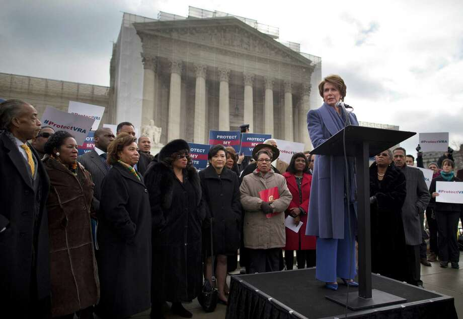 House Minority Leader Nancy Pelosi speaks at a rally of Voting Rights Act supporters outside the Supreme Court. Justices are hearing a challenge to Section 5, which some say unfairly targets the South despite racial electoral gains. Photo: Evan Vucci, STF / AP