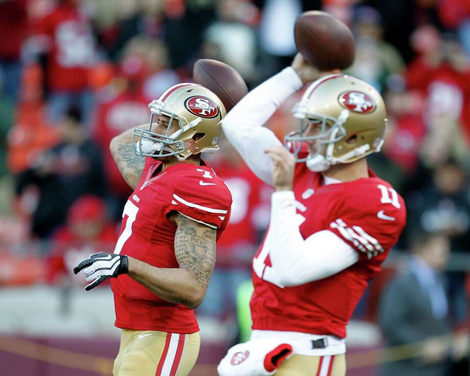 The emergence of Colin Kaepernick, left, has made Alex Smith expendable for the 49ers. Photo: Tony Avelar, FRE / FR155217 AP