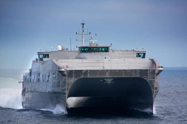 The USNS Spearhead is the first of 10 Navy joint high-speed vessels designed to quickly move troops and equipment. The 338-foot-long aluminum catamarans can transport 600 short tons of military cargo 1,200 nautical miles at an average speed of 35 knots, and operate in shallow-draft ports and waterways. Photo: U.S. Navy Photo Courtesy Austal USA, U.S. Navy