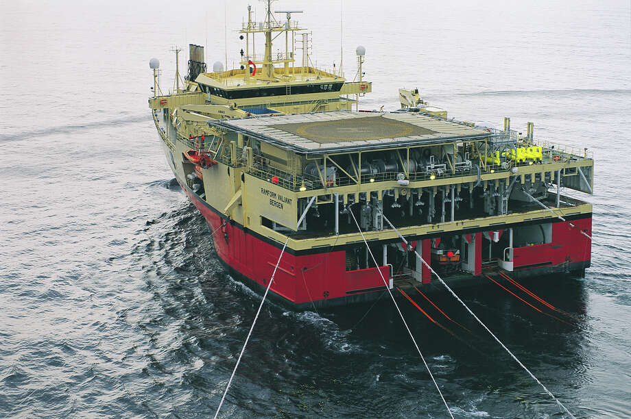 Ramform Valiant is one of a series of Ramform a Petroleum Geo-Services ships that conduct deep-water seismic exploration by towing cables containing hydrophones. The unique hull shape provides stability and lots of space in the rear for equipment. Photo: Petroleum Geo-Services