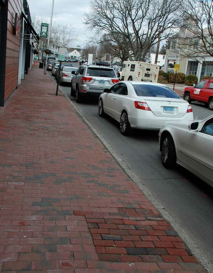"The Westport Downtown Merchants Association paid to have  trees removed along Main Street, replacing the empty spots with new brick, foreground. Steve Desloge, president of the association, said the DMA was responsible for planting the trees  ""about 10 years ago."" Photo: Jarret Liotta / Westport News contributed"