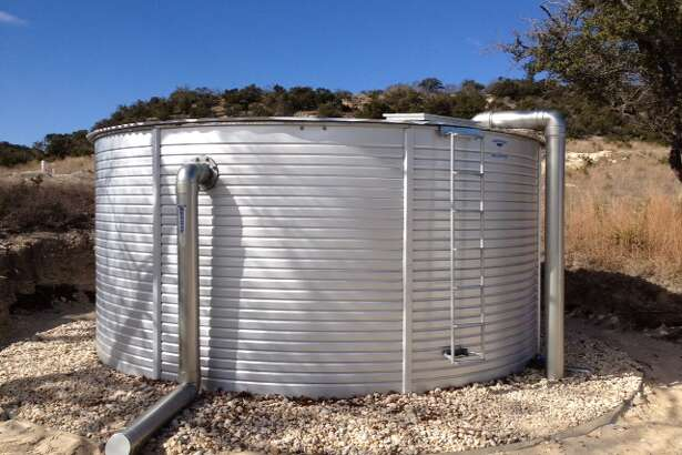 A 10,000-gallon galvanized metal tank will collect and store rainwater for household use.