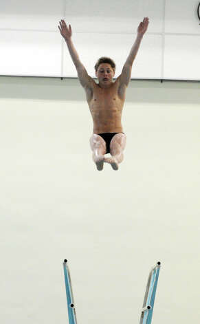 Lee Christensen of Darien High School during the FCIAC Diving finals at Westhill High School, Wednesday, Feb. 27, 2013. Photo: Bob Luckey / Greenwich Time