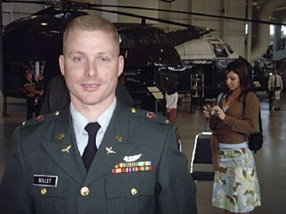 Jeremy Goulet is seen in a 2005 photo in front of a Blackhawk helicopter. Goulet allegedly killed two police officers in Santa Cruz on February 26, 2013.
