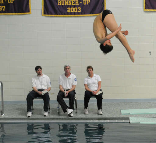 Bobby Ross of New Canaan High School during the FCIAC Diving finals at Westhill High School, Wednesday, Feb. 27, 2013. Photo: Bob Luckey / Greenwich Time