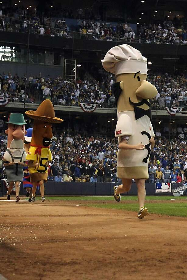 A view of the Sausage Race, including Guido, right, during Game Two of the National League Championship Series between the St. Louis Cardinals and the Milwaukee Brewers at Miller Park on October 10, 2011 in Milwaukee, Wisconsin. Photo: Jonathan Daniel, Getty Images