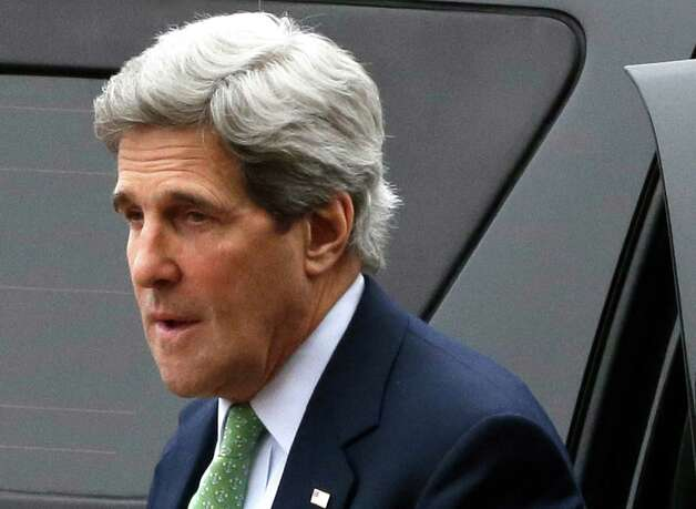 This photo taken Feb. 27, 2013 shows Secretary of State John Kerry arriving at the Foreign Ministry in Paris. The U.S. is moving closer to direct involvement in Syria's civil war with the delivery of non-lethal assistance directly to the rebels fighting President Bashar Assad's regime. Officials say the decision to offer ready-made meals and medical supplies to the rebels may be a step toward eventual U.S. military aid, which the administration has so far resisted.  (AP Photo/Jacquelyn Martin, Pool) Photo: Jacquelyn Martin