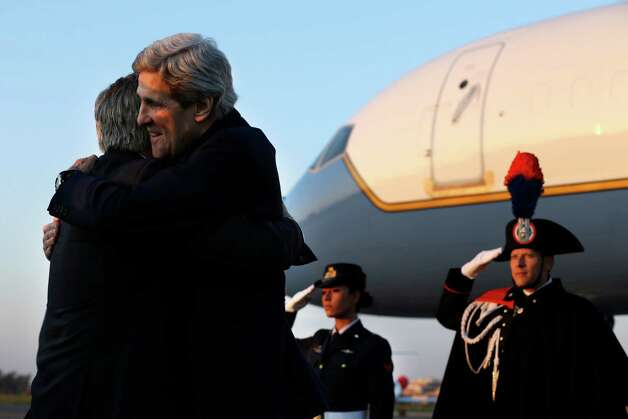U.S. Secretary of State John Kerry embraces his long time friend, U.S. Ambassador to Italy David Thorne, left, as Kerry arrives at Ciampino Airport, in Rome on Wednesday, Feb. 27, 2013. where talks on Syria will be held. Rome is the fourth leg of Kerry's first official overseas trip, a hectic nine-day dash through Europe and the Middle East. (AP Photo/Jacquelyn Martin, Pool) Photo: Jacquelyn Martin