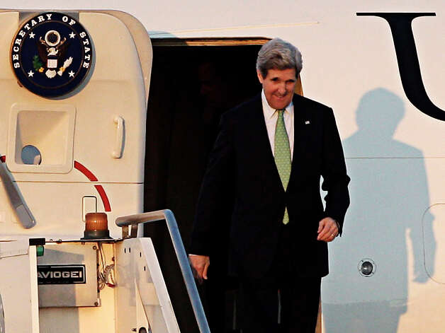 U.S. Secretary of State John Kerry disembarks at Ciampino military airport, in the outskirts of Rome, Wednesday, Feb. 27, 2013. Kerry will attend an international conference on Syria in Rome Thursday. The United States is looking for more tangible ways to support Syria's rebels and bolster a fledgling political movement that is struggling to deliver basic services after nearly two years of civil war, U.S. Secretary of State John Kerry said Wednesday. (AP Photo/Riccardo De Luca) Photo: Riccardo De Luca