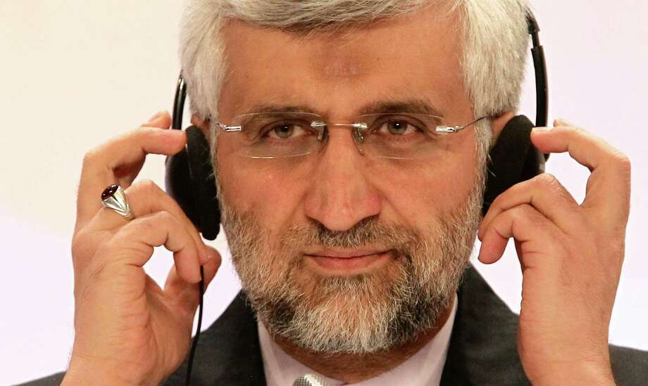 "Iran's Supreme National Security Council Secretary and chief nuclear negotiator Saeed Jalili listens to a question during a final news conference in Almaty, Kazakhstan, Wednesday, Feb. 27, 2013. Negotiations with world powers over how to curb Iran's nuclear program have reached a ""turning point"" for the better after nearly breaking down last year, the Islamic republic's top official at diplomatic talks said Wednesday at the close of two days of delicate discussions aimed at preventing Tehran from building an atomic arsenal. (AP Photo/Pavel Mikheyev) Photo: Pavel Mikheyev"