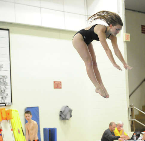 Kate Ray of New Canaan High School during the FCIAC Diving finals at Westhill High School, Wednesday, Feb. 27, 2013. Photo: Bob Luckey / Greenwich Time