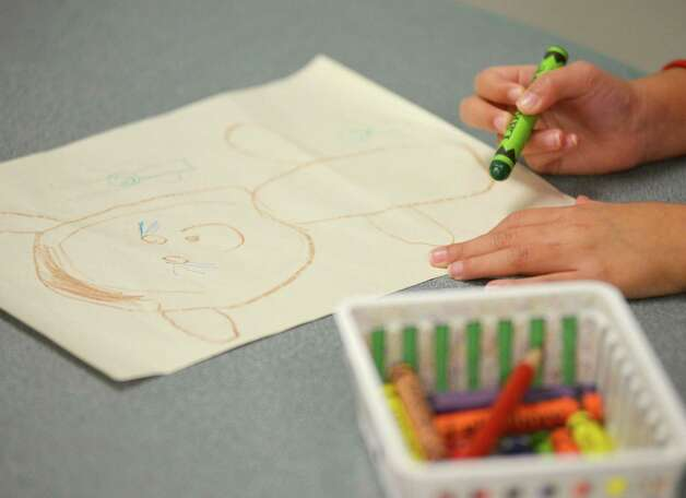 A student participates in art lessons during a pre-K Head Start bilingual class on Feb. 27, 2013, at Somerset Early Childhood Elementary in Somerset. Photo: Darren Abate, Darren Abate/San Antonio Express