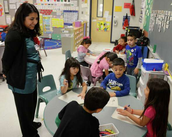 Teacher Debra Gonzalez interacts with students in a pre-K Head Start bilingual class on Feb. 27, 2013, at Somerset Early Childhood Elementary in Somerset. Photo: Darren Abate, Darren Abate/San Antonio Express