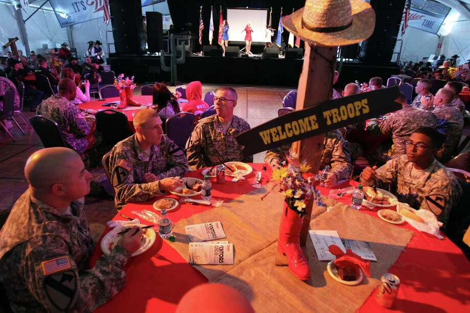 Troops listen to Liberty Bells and eat lunch on Armed Forces appreciation day at the Houston Livestock Show & Rodeo on Wednesday, Feb. 27, 2013, in Houston. Photo: Mayra Beltran, Houston Chronicle / © 2013 Houston Chronicle
