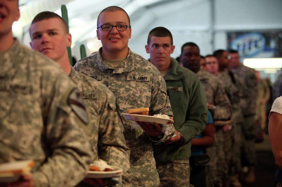 Pvt. Norberto Ramirez smiles while listening to USO LIberty Bells inside the Hideout on Armed Forces appreciation day at the Houston Livestock Show & Rodeo on Wednesday, Feb. 27, 2013, in Houston. Photo: Mayra Beltran, Houston Chronicle / © 2013 Houston Chronicle
