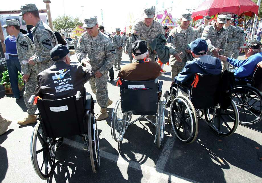 World War II veterans greet troops arriving from Fort Hood outside the Hide Out to eat lunch on Armed Forces Appreciation Day. Photo: Mayra Beltran, Houston Chronicle / © 2013 Houston Chronicle