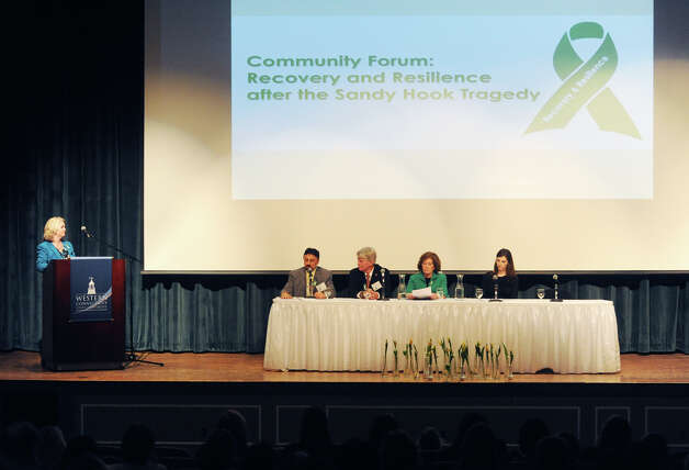 Kim Morgan, left, CEO of the United Way of Western Connecticut, with the panel of speakers at the United Way Community Forum, Recovery and Resilience after the Sandy Hook Tragedy, at Ives Concert Hall on the Western Connecticut State University campus in Danbury, Conn. Wednesday, Feb. 27, 2013.  Speakers included Frank DeAngelis, principal of Columbine High School; Chaplain Greg Young, chaplain and trainer for the FBI who responded to the 2012 Sikh temple shooting; Mary Fletchet, founder of VOICES of September 11th; and Jamie M. Howard, Ph.D., clinical psychologist at Child Mind Institute. Photo: Tyler Sizemore / The News-Times