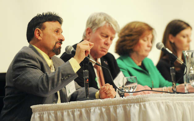 Frank DeAngelis, left, speaks at the United Way Community Forum, Recovery and Resilience after the Sandy Hook Tragedy, at Ives Concert Hall on the Western Connecticut State University campus in Danbury, Conn. Wednesday, Feb. 27, 2013.  DeAngelis is principal of Columbine High School and spoke about the Columbine massacre and how he dealt with issues after the shooting.  Other speakers included Chaplain Greg Young, chaplain and trainer for the FBI who responded to the 2012 Sikh temple shooting; Mary Fletchet, founder of VOICES of September 11th; and Jamie M. Howard, Ph.D., clinical psychologist at Child Mind Institute. Photo: Tyler Sizemore / The News-Times
