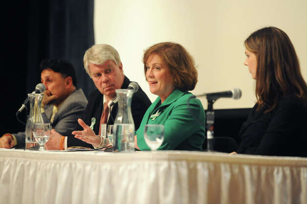 Mary Fletchet, second from right, speaks at the United Way Community Forum, Recovery and Resilience after the Sandy Hook Tragedy, at Ives Concert Hall on the Western Connecticut State University campus in Danbury, Conn. Wednesday, Feb. 27, 2013.  Fletchet's son, Brad, was killed in the 9/11 attacks and Fetchet founded VOICES of September 11th, and organization that addresses the ongoing needs of 9/11 families, rescue workers and survivors. Photo: Tyler Sizemore / The News-Times