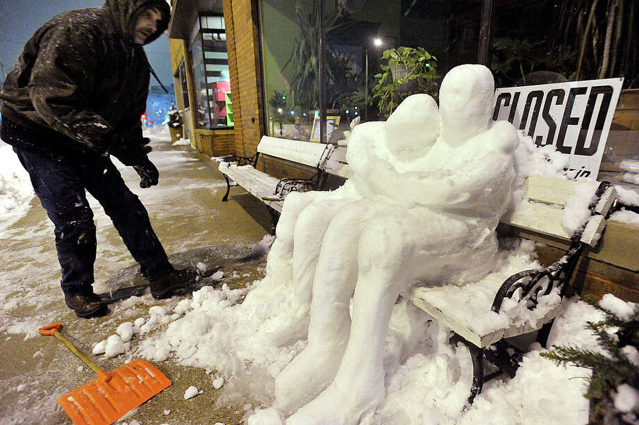 Dale Colson works on a snow sculpture of a couple hugging in downtown Kenosha, Wis., Tuesday, February 26, 2013. Colson made the work in recognition of the area homeless that have to sleep outside after the snowstorm. Photo: Brian Passino, Associated Press / Kenosha News
