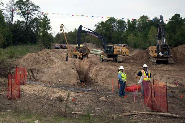 Workers make way for Keystone XL pipeline near Winnsboro. TransCanada waits on federal approval to cross the U.S.-Canada border before building a pipeline segment farther north. Photo: New York Times File Photo