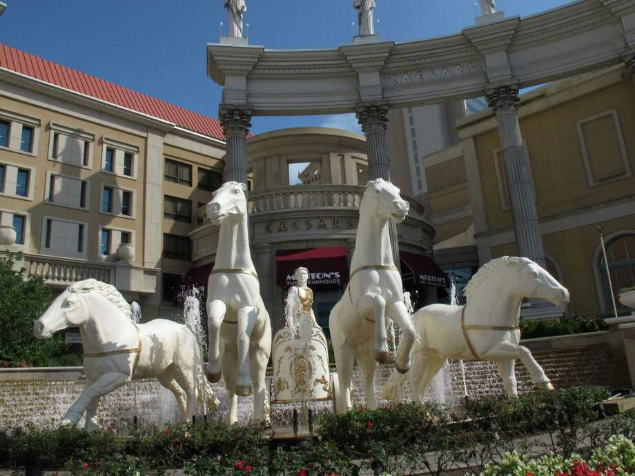 Statues of a Roman centurion and horses greet visitors to Caesars Atlantic City, shown here in Atlantic City N.J. on Oct. 3, 2011. Caesars Entertainment is expected to be a major player in the Internet gambling market, which is shaping up as a competition between Nevada and New Jersey, both of which have recently approved online gambling laws. (AP Photo/Wayne Parry) Photo: Wayne Parry