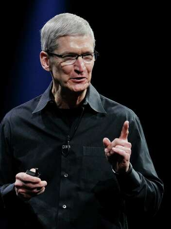 Apple CEO Tim Cook gestures at the Apple Developers Conference in San Francisco, Monday, June 11, 2012. New iPhone and Mac software and updated Mac computers were among the highlights Monday at Apple Inc.'s annual conference for software developers. (AP Photo/Paul Sakuma) Photo: Paul Sakuma / AP
