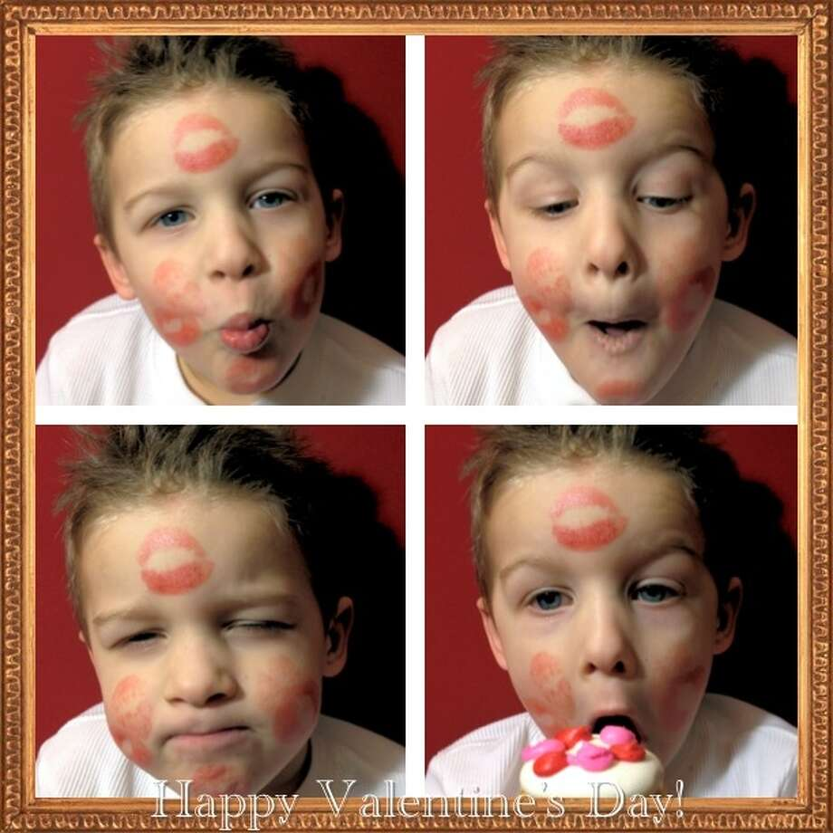 Four-year-old Zachary Trippany of Rotterdam shows the result of a Valentines Day illustration with lipstick kisses. His mom, Kelli, says she used a cupcake as an incentive. (Kelli Trippany)