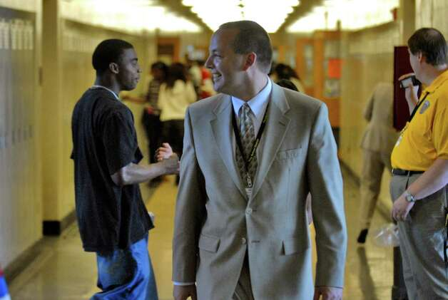 John Carmello walks the halls of Troy High School. (Times Union archive) Photo: PHILIP KAMRASS / ALBANY TIMES UNION