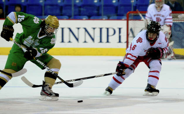 Fairfield Prep's #6 Kevin Brown tries to intercept the puck from Notre Dame of West Haven's #15 Matt Dumas, during SCC boys hockey playoff championship action at High Point Solutions Arena at Quinnipiac University in Hamden, Conn. on Wednesday February 27, 2013. Photo: Christian Abraham / Connecticut Post