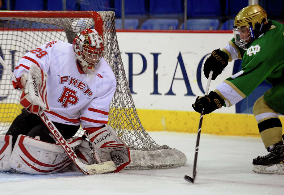 Fairfield Prep goalie Matt Beck prepares for a shot attempt by Notre Dame of West Haven's #7 Greg Zullo, during SCC boys hockey playoff championship action at High Point Solutions Arena at Quinnipiac University in Hamden, Conn. on Wednesday February 27, 2013. Photo: Christian Abraham / Connecticut Post