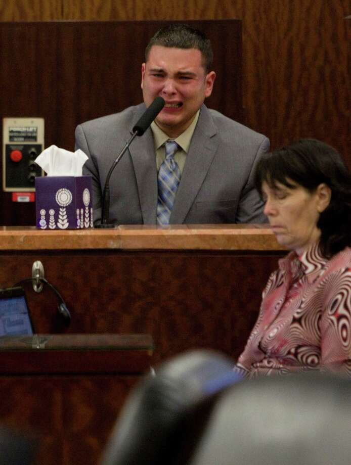Marcos Garza, who was driving drunk when he crashed into Sister Therese Huong Do's car, killing her, becomes emotional during the punishment phase of his trial. He begged for forgiveness. Photo: Johnny Hanson, Staff / © 2013  Houston Chronicle