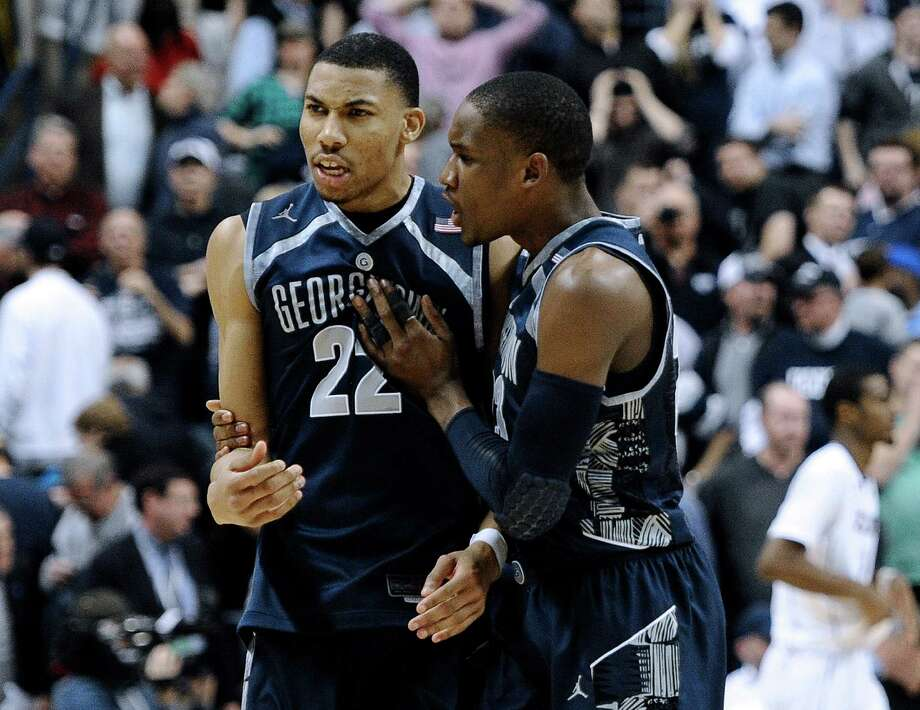 Georgetown's Otto Porter Jr., left, and Georgetown's Aaron Bowen right celebrate their double overtime win in an NCAA college basketball game against Connecticut in Storrs, Conn., Wednesday, Feb. 27, 2013. Georgetown won 79-78. (AP Photo/Jessica Hill) Photo: Jessica Hill, Associated Press / FR125654 AP