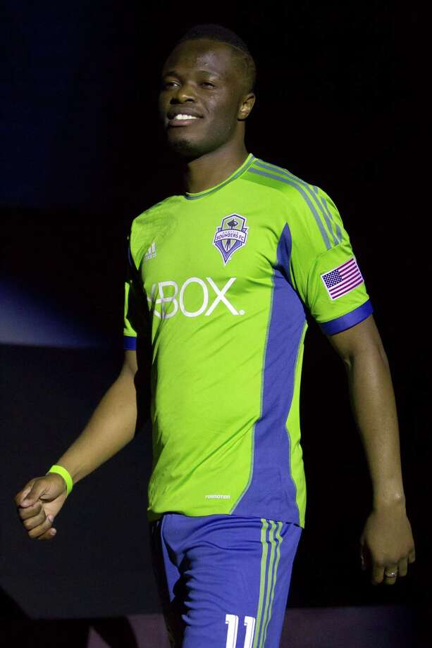 Sounders FC midfielder Steve Zakuani shows off the new 2013 season primary uniform of the Seattle Sounders FC on Wednesday, Feb. 27, 2013, at the Cinerama in downtown Seattle, Wash. Both outfits - primary and secondary - boasted reduced fabric weights and a change in some stitching materials. Photo: JORDAN STEAD / SEATTLEPI.COM