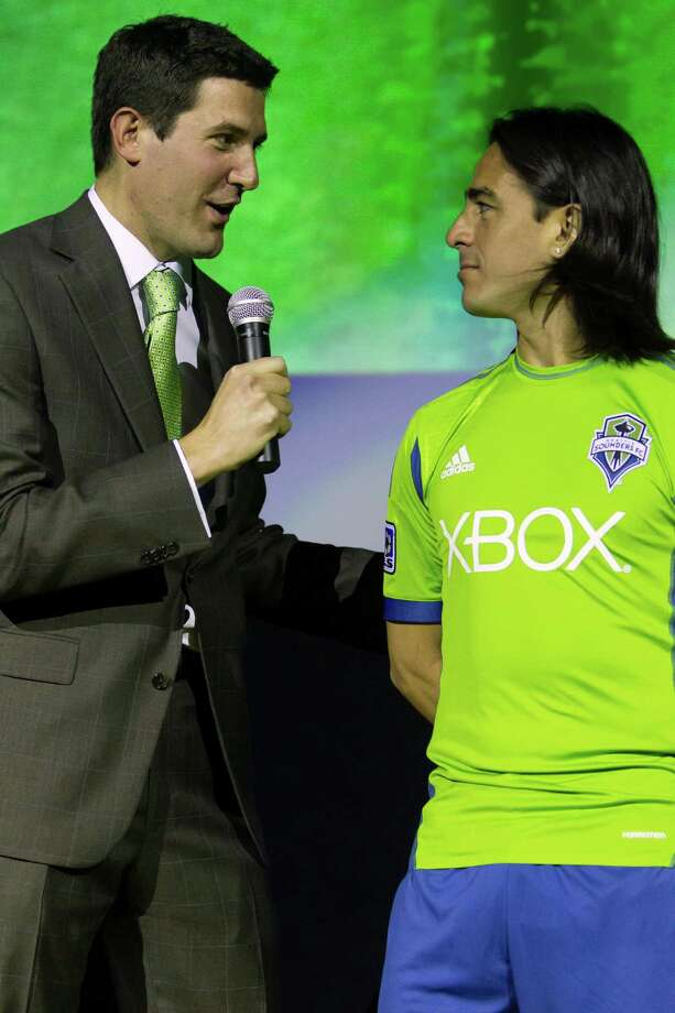 Announcer Ross Fletcher, left, addresses Sounders FC player Mauro Costales at the unveiling event for the new 2013 season uniforms of the Seattle Sounders FC on Wednesday, Feb. 27, 2013, at the Cinerama in downtown Seattle, Wash. Both outfits - primary, in green, and secondary, in slate - boasted reduced fabric weights and a change in some stitching materials. Photo: JORDAN STEAD / SEATTLEPI.COM